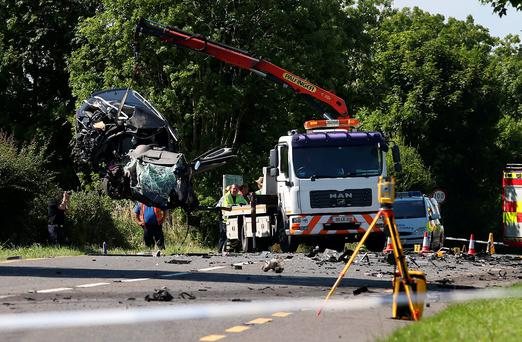 The wreckage of a car is lifted to a recovery vehicle at the scene where A father and his young son have been killed in a collision involving a car and truck on the N24 between Pallasgreen and Oola in Co Limerick this morning. Picture credit; Damien Eagers
