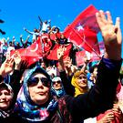 Pro-government supporters chant slogans and wave Turkish flags as they protest against the coup. Photo: Lefteris Pitarakis