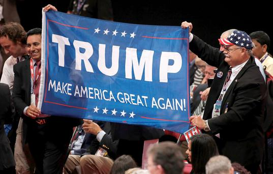 Delegates parade a Donald Trump banner around the floor at the Republican National Convention in Cleveland, Ohio. Picture Credit: REUTERS/Mike Segar