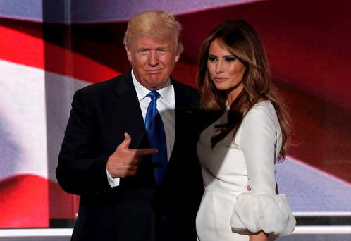 Republican US presidential candidate Donald Trump with his wife Melania after she concluded her remarks at the Republican National Convention in Cleveland, Ohio