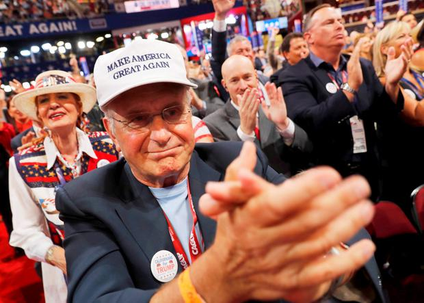 Delegates applaud during voting on the Trump nomination at the Republican National Convention in Cleveland, Ohio