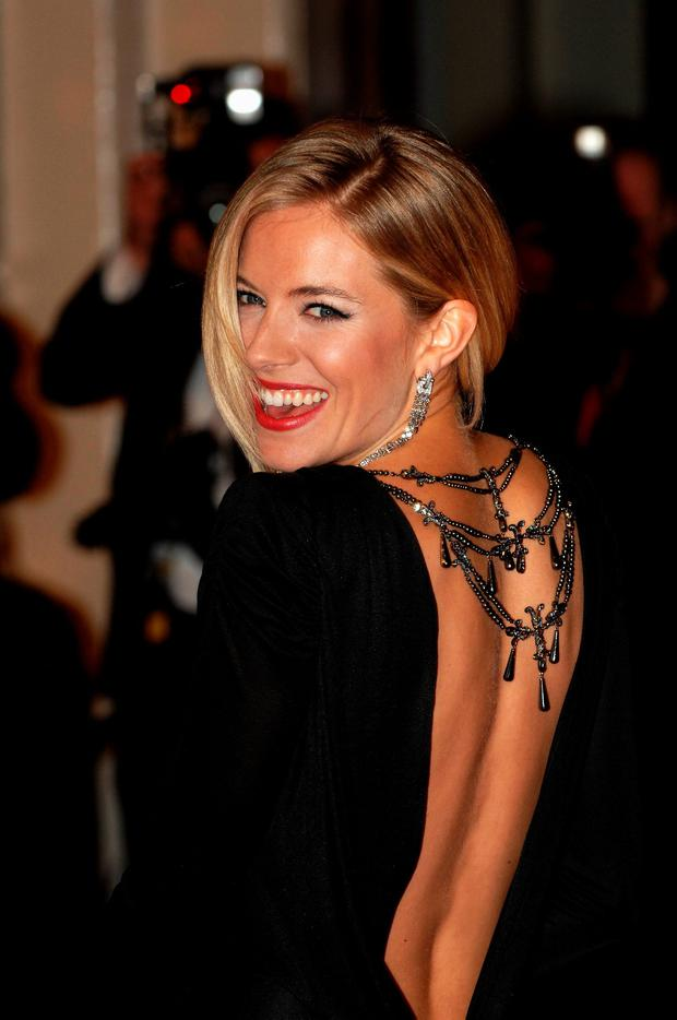 Actress Sienna Miller arrives at the Orange British Academy Film Awards at the Royal Opera House on February 10, 2008 in London, England. (Photo by Jorge Herrera/Getty Images)