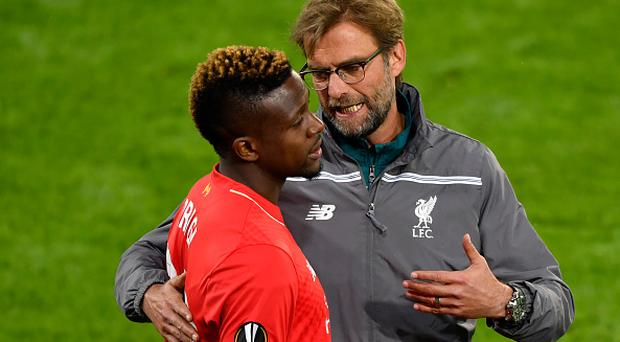 Liverpool's German coach Jurgen Klopp (R) speaks with Liverpool's Belgian forward Divock Origi during the UEFA Europa League final football match between Liverpool FC and Sevilla FC at the St Jakob-Park stadium in Basel, on May 18, 2016. AFP PHOTO / FABRICE COFFRINI / AFP / FABRICE COFFRINI (Photo credit should read FABRICE COFFRINI/AFP/Getty Images)