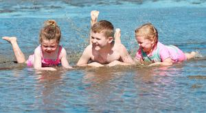 Three year old Saoirse Gallagher with Alex [8] and Evie [5] Doyle from Cabra, cool down the water on Dublin's Dollymount Strand. Picture Credit : Frank Mc Grath 18/7/16