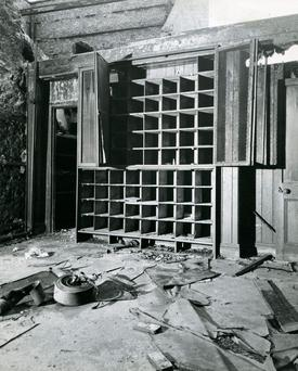 1951: Abbey Fire: The roof had collapsed and there is a fire hose on the ground.