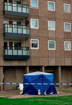 Police at the scene at Donside Court, Tillydrone, Aberdeen, where three people died following a disturbance Credit: Laura Paterson/PA Wire