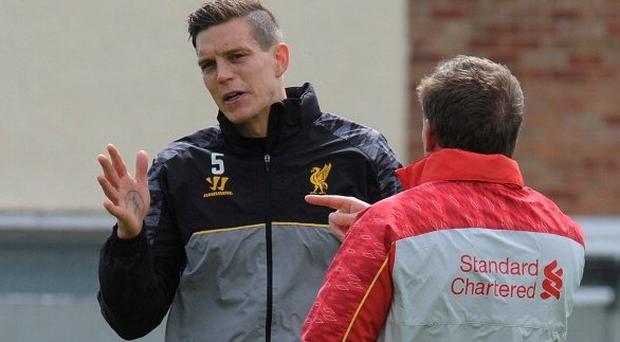 Daniel Agger chats with Brendan Rodgers during their days at Liverpool