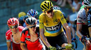 Britain's Chris Froome, wearing the overall leader's yellow jersey, is followed by Australia's Richie Porte, as they climb during the seventeenth stage of the Tour de France cycling race over 184.5 kilometers (114.3 miles) with start in Bern and finish in Finhaut-Emosson, Switzerland
