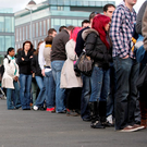 People queue for the Working Abroad Expo in Dublin's RDS in early 2012. The population grew over the past half a decade despite migration Photo: Gerry Mooney
