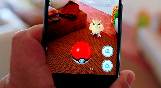 'For those of you who have been living in a cave, blissfully unaware of the craze that has taken over the world, Pokémon Go is an online mobile game that involves a virtual treasure hunt to 'catch' characters in places like gardens, churches, police stations, museums, etc' Photo: REUTERS/Sam Mircovich/Illustration/File Photo