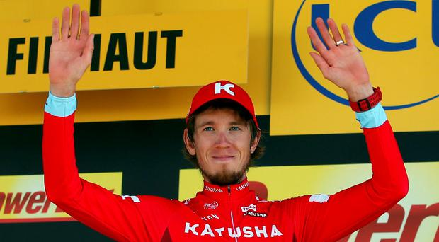 Team Katusha rider Ilnur Zakarin on the podium after winning yesterday's stage. Picture: REUTERS/Juan Medina
