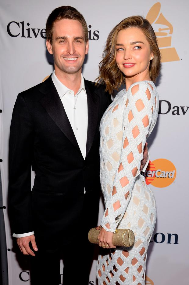 Co-founder and CEO of Snapchat Evan Spiegel (L) and model Miranda Kerr attend the 2016 Pre-GRAMMY Gala and Salute to Industry Icons honoring Irving Azoff at The Beverly Hilton Hotel on February 14, 2016 in Beverly Hills, California. (Photo by Kevork Djansezian/Getty Images)