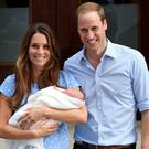 Prince George outside the Lindo Wing of St Mary's Hospital, London with his parents Kate Middleton and Prince William.