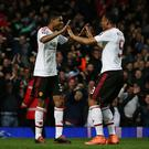 LONDON, ENGLAND - APRIL 13: Marcus Rashford of Manchester United celebrates scoring the opening goal with Anthony Martial of Manchester United during The Emirates FA Cup, sixth round replay between West Ham United and Manchester United at the Boleyn Ground on April 13, 2016 in London, England. (Photo by Ian Walton/Getty Images)