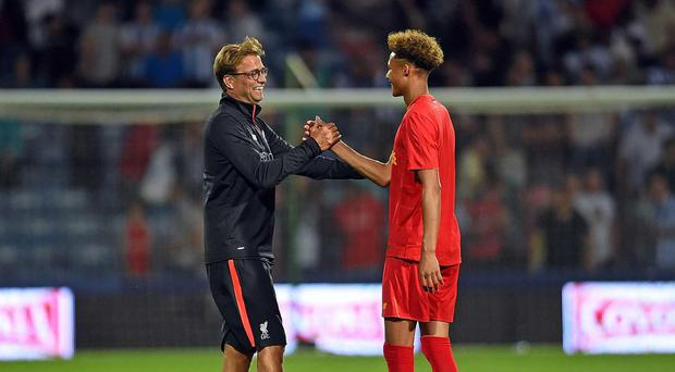 Liverpool manager Jurgen Klopp embraces goalkeeper Shamal George after he played up front in the friendly win against Hudderfield. Getty