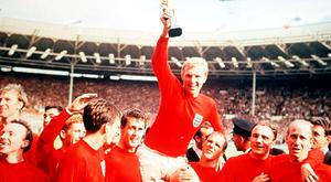 Height of success: Bobby Moore and the rest of the English squad celebrate winning the 1966 World Cup
