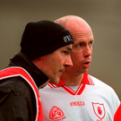 Peter Canavan and Mickey Harte chat on the sideline during the 2003 League final. Photo: Sportsfile