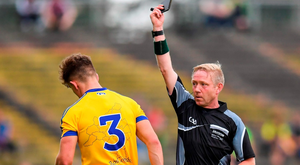 Roscommon's Seán Mullooly receives a black card from referee Ciarán Branagan during the Connacht SFC Final replay last Sunday. Photo: Stephen McCarthy/Sportsfile