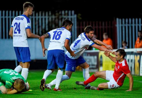 Christy Fagan of St Patrick's Athletic is pushed over by Dinamo Minsk players during the UEFA Europa league Second Qualifying Round 2nd Leg match between St Patrick's Athletic and Dinamo Minsk at Richmond Park in Inchicore, Dublin. Photo by David Maher/Sportsfile