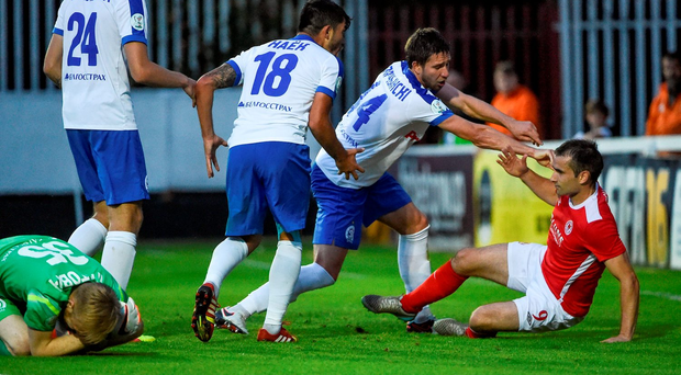 Dinamo Minsk players confront Christy Fagan during their victory over St Pat's last night. Photo: Sportsfile