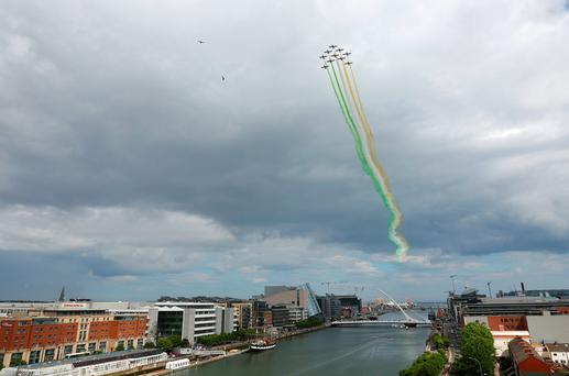 Members of the Italian aerobatic display team Frecce Tricolori flying over Dublin city centre yesterday ahead of the Bray Air Display tomorrow and Sunday. Photo: Damien Eagers