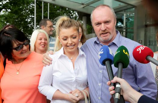 Rose Kenny's brother Paul and daughter Jamie speak to the media outside the Central Criminal Court in Dublin yesterday. Photo: Collins Courts