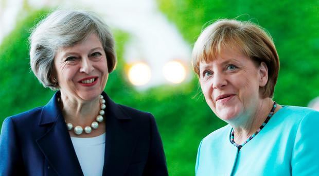 German Chancellor Angela Merkel greets British Prime Minister Theresa May Picture: REUTERS/Hannibal Hanschke