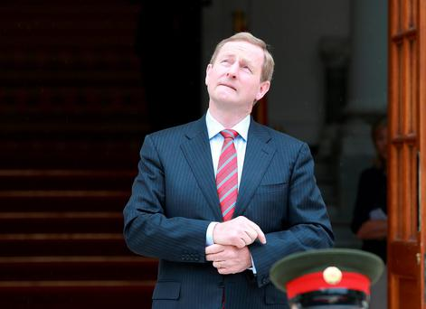 Taoiseach Enda Kenny awaits the arrival of French President Francois Hollande yesterday. Photo: Frank McGrath