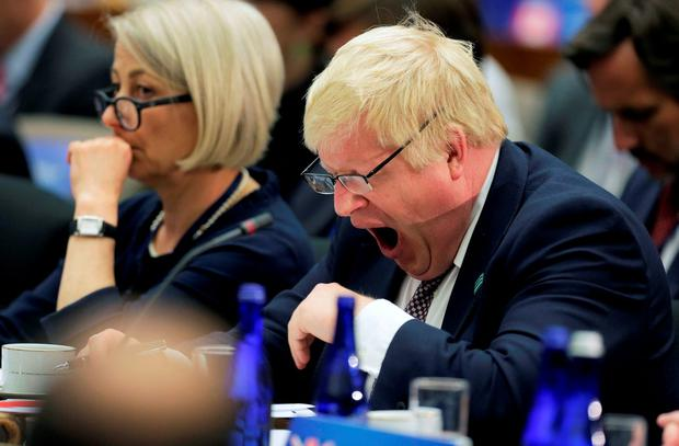 British Foreign Secretary Boris Johnson yawns during the