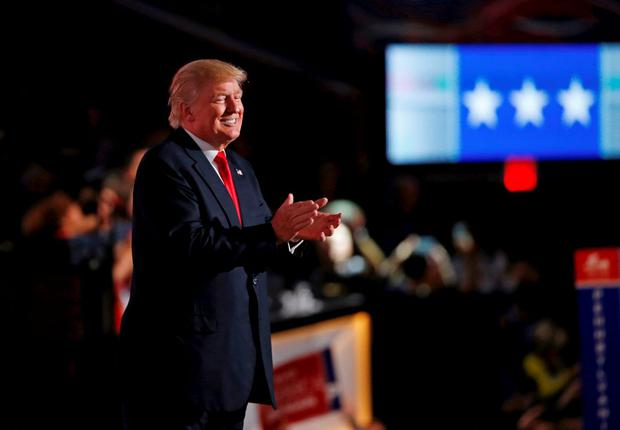 Republican presidential nominee Donald Trump applauds at the conclusion of the Republican National Convention in Cleveland, Ohio, U.S. July 21, 2016. REUTERS/Mario Anzuoni