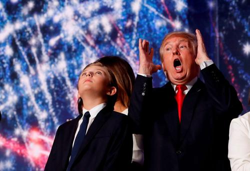 Republican U.S. presidential nominee Donald Trump reacts to balloons, confetti and electronic fireworks as he stands with his son Barron (L) at the conclusion of the final session of the Republican National Convention in Cleveland, Ohio, US. Photo: REUTERS/Jonathan Ernst
