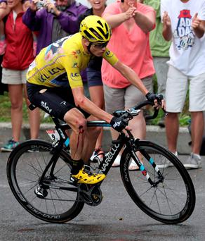 Yellow jersey leader Team Sky rider Chris Froome nurses a number of cuts and bruises after today's crash