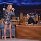 "NEW YORK, NY - JULY 21: Host Jimmy Fallon (R) looks on as singer Celine Dion performs on ""The Tonight Show Starring Jimmy Fallon"" at Rockefeller Center on July 21, 2016 in New York City. (Photo by Mike Coppola/Getty Images for NBC)"