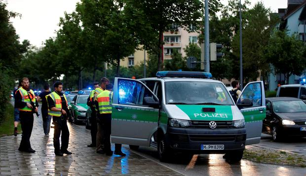 Police secure a street near to the scene of a shooting in Munich, Germany July 22, 2016. REUTERS/Michael Dalder TPX IMAGES OF THE DAY
