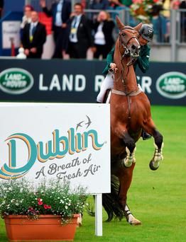 Denis Lynch, Ireland, holds on to All Star 5 as they approach the final hurdle during a jump-off against eventual winner Italy the Furusiyya FEI Nations Cup presented by Longines at the Dublin Horse Show in the RDS, Ballsbridge, Dublin. Photo by Cody Glenn/Sportsfile