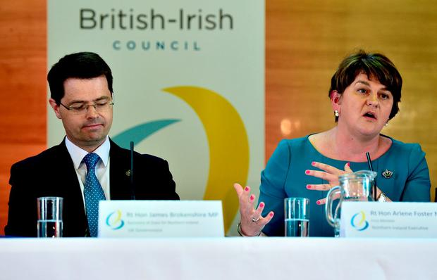 Secretary of State for Northern Ireland James Brokenshire listens as Northern Ireland First Minister Arlene Foster speaks during a press conference following an emergency meeting of the British Irish Council in Cardiff. Photo: Ben Birchall/PA Wire
