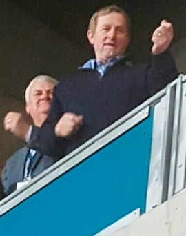 Enda Kenny plays air guitar at the Bruce Springsteen concert at Croke Park.