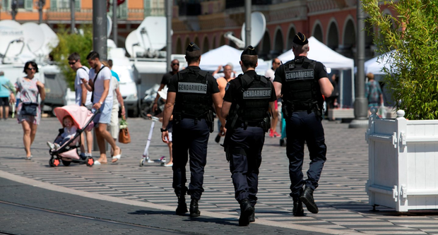 French police patrol the area of the terror attack in Nice. Photo: Kyran O'Brien