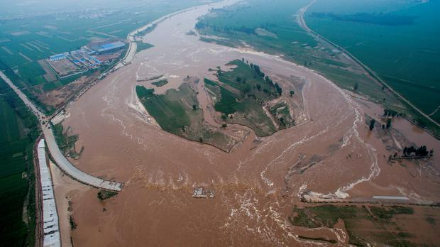 An aerial view shows that roads and fields are flooded in Xingtai, Hebei Province, China, July 21, 201