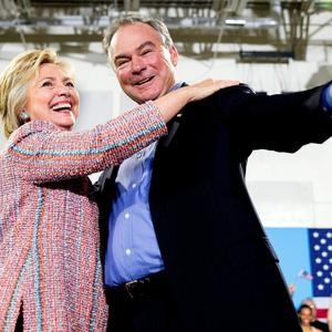 In this July 14, 2016, file photo, Democratic presidential candidate Hillary Clinton, accompanied by Sen. Tim Kaine, D-Va