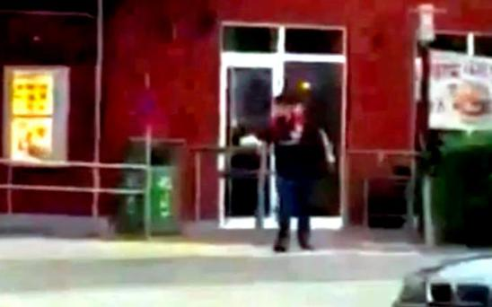 A screengrab of a video appears to show the gunman outside a McDonald's.