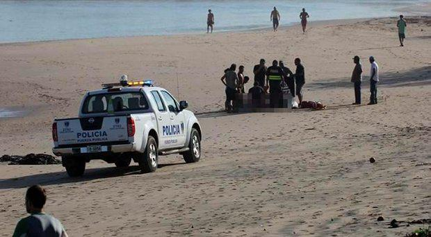 Emergency services assist the wounded surfer on Tamarindo beach