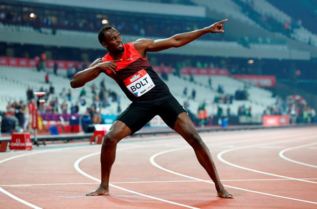 Usain Bolt celebrates after winning the Men's 200m in London