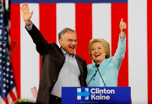 Democratic U.S. vice presidential candidate Senator Tim Kaine (D-VA) waves with his presidential running-mate Hillary Clinton after she introduced him during a campaign rally in Miami, Florida. Reuters/Scott Audette
