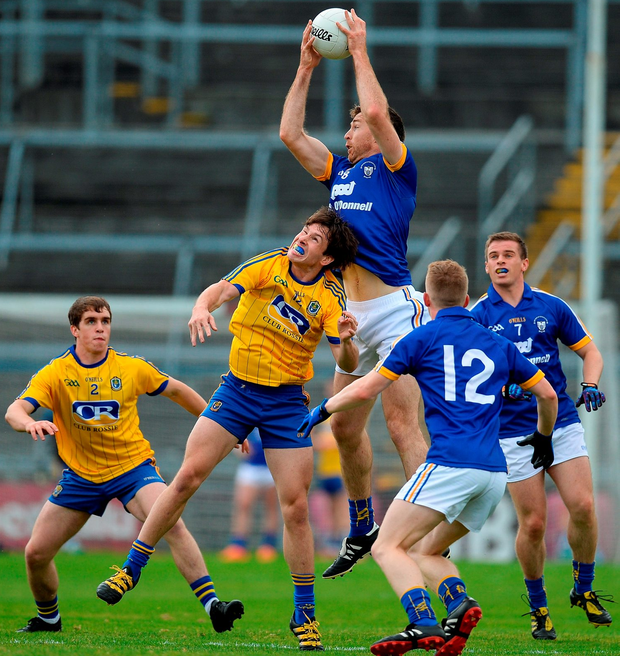 Gary Brennan of Clare in action against David keenan of Roscommon Photo: Brendan Moran/Sportsfile