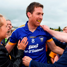 Gary Brennan celebrates with supporters after Clare's victory. Photo: Brendan Moran