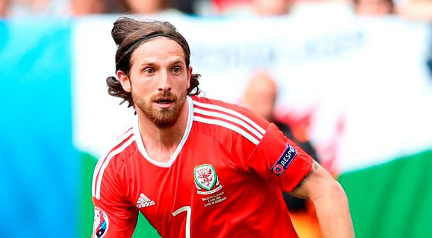 Joe Allen is set to have talks with Stoke City manager Mark Hughes today. Photo: Martin Rickett/PA Wire.