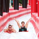 Linda Martin and TV star Cormac Branagan at the HB Ice Cream 98FM Big Slide Home at Christchurch, Dublin. Picture: Leon Farrell/Photocall Ireland.