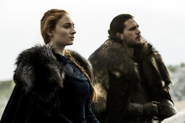 Sophie Turner as Sansa Stark, left and Kit Harington as Jon Snow, right in Game of Thrones