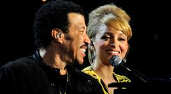 Musician Lionel Richie (L) and his daughter Nicole Richie perform onstage during Lionel Richie and Friends in Concert presented by ACM held at the MGM Grand Garden Arena on April 2, 2012 in Las Vegas, Nevada. (Photo by Ethan Miller/Getty Images)
